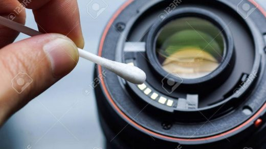 Hand Using A Cotton Swab To Clean Camera Lens Contacts / Digital.. Stock  Photo, Picture And Royalty Free Image. Image 62173458.