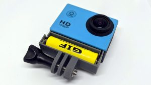 External Battery Mod For Action Camera Does It Non-destructively | Hackaday