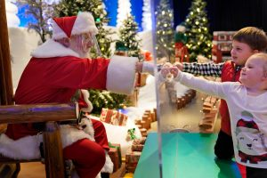 Here comes Santa Claus — with face masks and plexiglass – The Denver Post