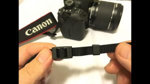 Attach a Neck strap to your DSLR camera...The Canon way!!! - YouTube