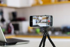You can use your iPhone or Android phone as a webcam. here's how